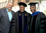 Student and BMI President Lawrence H. Johnson, at left in bow tie, joined Professor David Fullard and alumnus Jay Marshall '06, '08, at the 2013 Metropolitan Center graduation. Fullard, together with Johnson, Marshall and others, led the establishment of the BMI scholarship. (Photo/Marty Heitner)