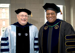 Empire State College faculty members Robert Carey, at left, and David Fullard seen at the 2013 Metropolitan Center graduation, are among the driving forces behind the establishment of the BMI Scholarship. (Photo/Marty Heitner)
