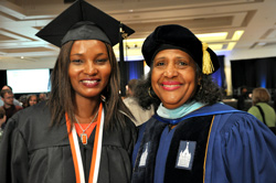 Student speaker Ruth Njoroge-Vondran and SUNY Trustee Eunice Lewin share smiles after graduation.