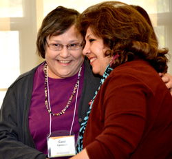 CDL Mentor Carol Carnevale, at left, learns she has received the Chancellor's Award for Excellence in Faculty Service and is congratulated by her colleague CDL Mentor Nazik Roufaile.