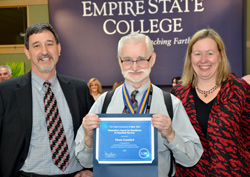 Vice President Paul Tucci and Acting President Meg Benke present Chuck Crawford, center, with the Chancellor's Award for Excellence in Classified Service.