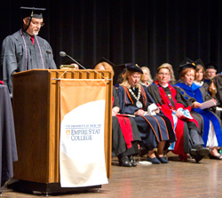 A veteran of the U.S. Armed Forces address the Central New York Center graduation. Images are by Michael J. Okoniewski of the 2013 Central New York Center graduation.
