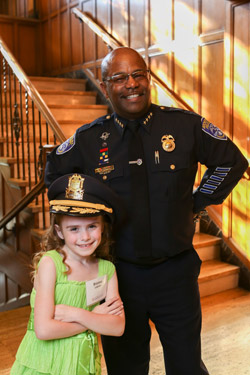 Brianna Collichio, who sang the National Anthem, and RPD Chief James Sheppard '99, at the annual Genesee Valley Center Community Event. Sheppard was recognized for his leadership and community service.