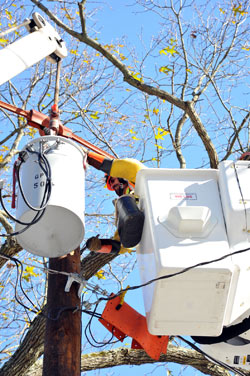 A member of the International Brotherhood of Electrical Workers helps to restore power in the aftermath of Hurricane Sandy. (Photo/IBEW Local 2032)
