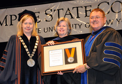 Acting President Meg Benke, left with the college's Presidential Medal recipient and Stewart's Foundation President Susan Dake, and Hugh Hammett, the college's vice president for external affairs.