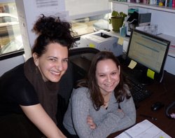Faculty Mentors Gina Torino, standing at left and Amanda-Sisselman,seated at right are happy to be back at the college's Staten Island Office.