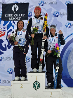 2014 Chancellor's Award for Student Excellence recipient and two-time Olympian Ashely Caldwell, center, is seen here after winning the 2014 USANA National Championships in Aerials, held March 29 at Park City Utah. Photo/Riley Steinmetz/U.S. Ski Team