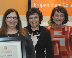 Karen Garner stands at left as the 2011 recipient of the Empire State College Foundation Susan H. Turben Award for Excellence in Scholarship. To Garner's right are 2010 recipient Nataly Tcherepashenets and Susan H. Turben