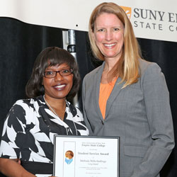 Melinda Wills-Stallings is presented with the college's student service award by President Merodie A. Hancock at the 2015 Student Wellness Retreat