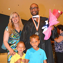 Graduate Matthew Canuteson and his wife, Lisa, with their sons, Abraham, 6, and Augustus, 4 at the reception following the 2015 commencement event held in Albany. Photo/Empire State College