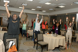 Students stand up and stretch at the 2015 Student Wellness Retreat