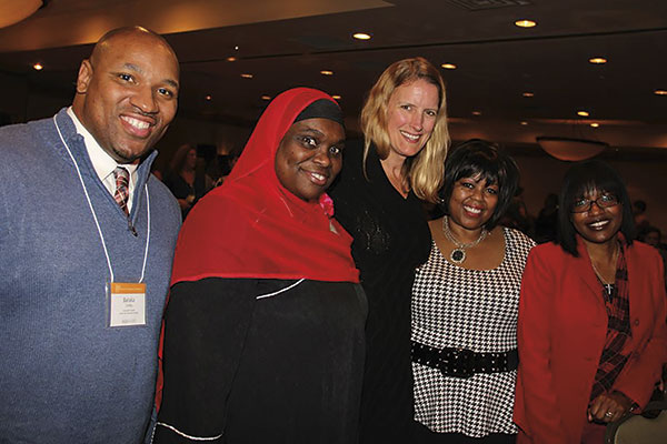 Members of Minority Students in Action stand with President Merodie Hancock at the annual Student Academic Conference. Second from left is Layla Abdullah-Poulos, founder 
