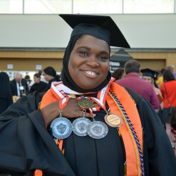 Layla Abdullah-Poulos displays her medallions and her Dean's Medal for her outstanding academic performance as a graduate student. Photo/Empire State College