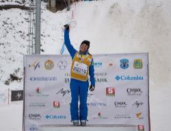 Ashley Caldwell '14 raise the FIS World Cup. Photo/USSA / Greg Heuer