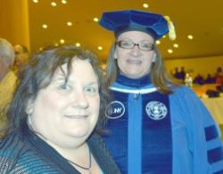Student Kim Russell, left, attended the 2014 Albany commencement, with her friend and current graduate student Lori Mould '14, seen in her regalia as the former SUNY student trustee.