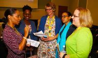 Professors Desalyn De-Souza, center, and Tracy Galuski, far right, participated in an early childhood development conference with the University of the West Indies.