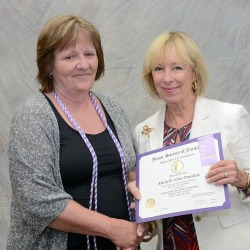 SUNY Empire nursing student Michelle Drysdale, left, is presented with her STTI certificate of induction by Barbara Pieper an associate dean at Excelsior College and one of the chapter's counselors. Photo/Tom Stock, www.saratogaphotographer.com