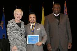 Chancellor Nancy Zimpher, at left, Jaime Lopez, a 2016 Chancellor's Award for Student Excellence recipient, and SUNY Empire State College Provost Alfred Ntoko at the presentation ceremony, which was held in Albany. Photo/SUNY