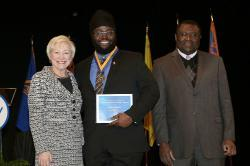 Chancellor Nancy Zimpher, at left, with Omar Richards, a 2016 Chancellor's Award for Student Excellence recipient, and SUNY Empire State College Provost Alfred Ntoko at the presentation ceremony, which was held in Albany. Photo/SUNY
