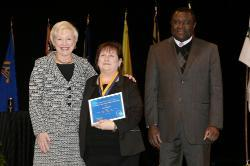 Chancellor Nancy Zimpher, at left, with Kim Russell, a 2016 Chancellor's Award for Student Excellence recipient, and SUNY Empire State College Provost Alfred Ntoko at the presentation ceremony, which was held in Albany. Photo/SUNY