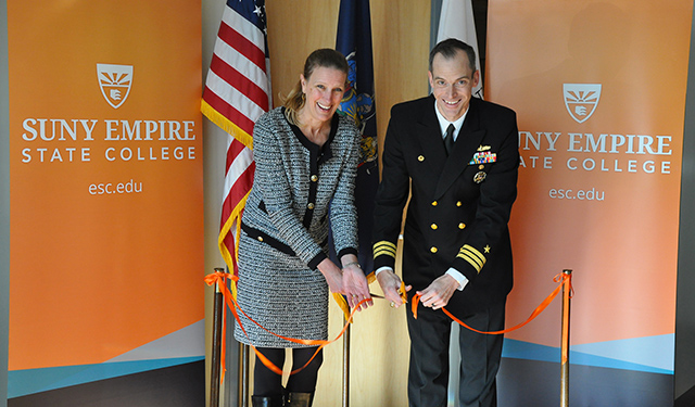 SUNY Empire State College President Merodie A. Hancock, at left, and U.S. Navy Commander Judd Krier cut a ceremonial ribbon opening the national testing center at the college.