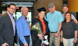 Student Speaker Claudia Parrington surrounded by her family after the Purchase commencement event.