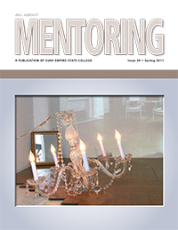 lit chandelier lying on a hardwood floor
